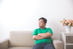 Fat man thinking and looking up to copyspace Stock Photos