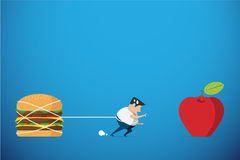 Fat man trying walk to red apple but hamburger hold him back, diet and health concept Stock Photos