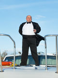 Fat man in tuxedo with glass wine Stock Images