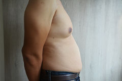 Fat man. Wearing jeans belly fat Royalty Free Stock Photos