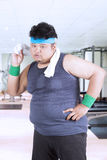 Fat man wiping sweat after exercise Royalty Free Stock Photo