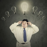Fat manager with lightbulb over head Royalty Free Stock Photos