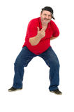 Fat mature guy dancing hip-hop. Fat mature guy in red shirt dancing hip-hop on a white background Stock Photos
