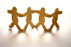 Fat Men. A paper cutout of 4 fat men standing holding hands together Stock Image