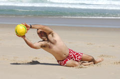 Fat men playing with a ball. On the beach Royalty Free Stock Photos