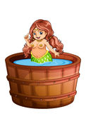 A fat mermaid taking a bath Stock Photo