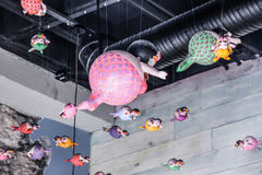 Fat mermaids hanging from the roof. Photograph of some toy fat mermaids hanging,from the roof Stock Images