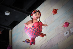 Fat mermaids hanging from the roof. Photograph of some toy fat mermaids hanging,from the roof Stock Image