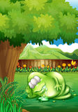A fat monster sleeping under the tree at the yard Stock Images