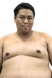 Fat naked upper body and belly stomach of an Asian African man s. Howing proud expression on his face in white isolated background Stock Photography