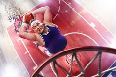 Fat non professional basketball player in action. Fun. Broken ba. Sketball court floor fun picture royalty free stock image