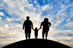 Fat, obese family is standing on a hill. Concept of obesity Stock Photography