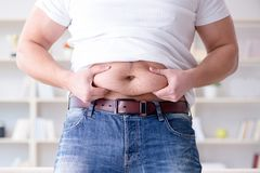 The fat obese man in dieting concept. Fat obese man in dieting concept Stock Photos