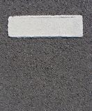 Fat  paint stripe line on gray grunge surface Stock Images