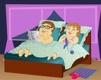 Fat people in bed. Fat people in the evening in bed together - the wife knits socks, husband with glasses reading a newspaper Stock Images