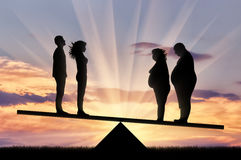 Fat people and couple thin stand on scales sunset Stock Images