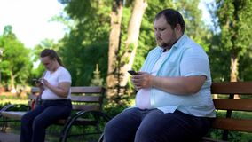 Fat people easy communicate in social network but afraid acquaintance in reality. Stock photo stock photos