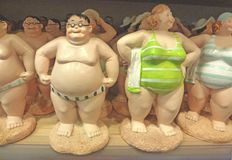 Fat people. Sculptures in bathing suit royalty free stock photo