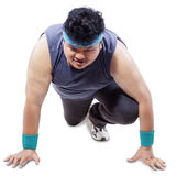 Fat person in ready position to run Royalty Free Stock Image