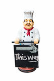 Fat plastic male chef doll holding a sign Stock Photos