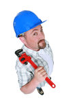Fat plumber holding tool Royalty Free Stock Images