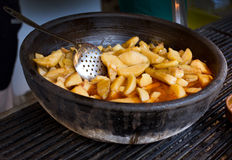 Fat potato in clay pot Stock Photo
