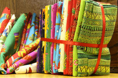 Fat Quilt Quarters. Close up of bold colorful fat quarters quilt material packages available for sale Stock Image