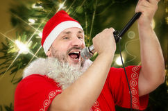 Fat Santa belting Jingle Bells Royalty Free Stock Photo