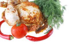 Fat spiced chicken with raw Royalty Free Stock Photos
