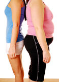 Fat thin. Two woman with different body shapes standing back to back Stock Image