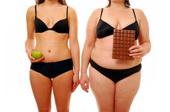 Fat and thin. Fat and slim women holding chocolate bar and healthy apple stock photo