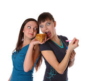 Fat and thin girls eatting Stock Image