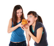 Fat and thin girls eatting Royalty Free Stock Images