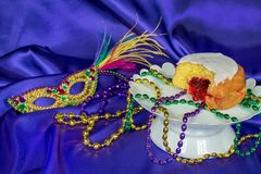 Paczki with Mardi Gras bead and mask Royalty Free Stock Images