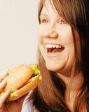 Fat white woman having choice between hamburger Stock Photos