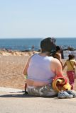 Fat woman. In the beach Stock Images