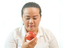Fat woman with apple Royalty Free Stock Photos