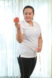 Fat woman with apple Stock Photography