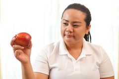 Fat woman with apple Stock Images