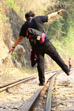 Fat woman balance on railway