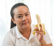 Fat woman with banana Stock Photography