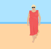 Fat woman on the beach Stock Image