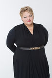 Fat woman in a beautiful dress Royalty Free Stock Photo