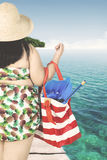 Fat woman carrying bag on jetty Stock Image