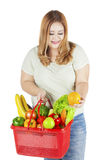Fat woman carrying vegetable Stock Image