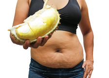 Fat woman and cholesterol. Women with fat belly and stretch marks hold the durian fruit has high cholesterol Royalty Free Stock Image