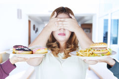 Fat woman closed eyes for junk food Royalty Free Stock Photography