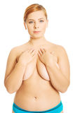 Fat woman covering her body Royalty Free Stock Image