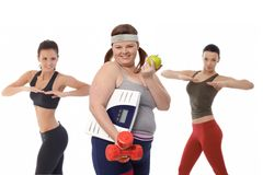 Fat woman on diet doing fitness exercise Stock Photography