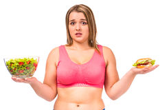 Fat woman dieting. The concept of healthy eating. Fat woman dieting isolated on a white background Royalty Free Stock Photo